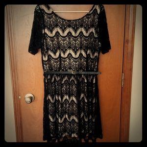Black lace over nude dress